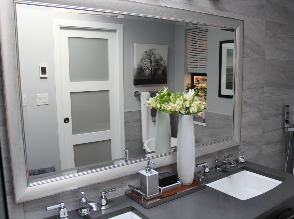 grey silestone countertop, framed mirror, complete marble look wall tile