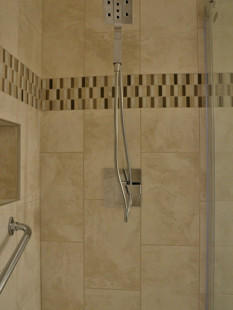 Walk-in tiled shower with niche and safety bars