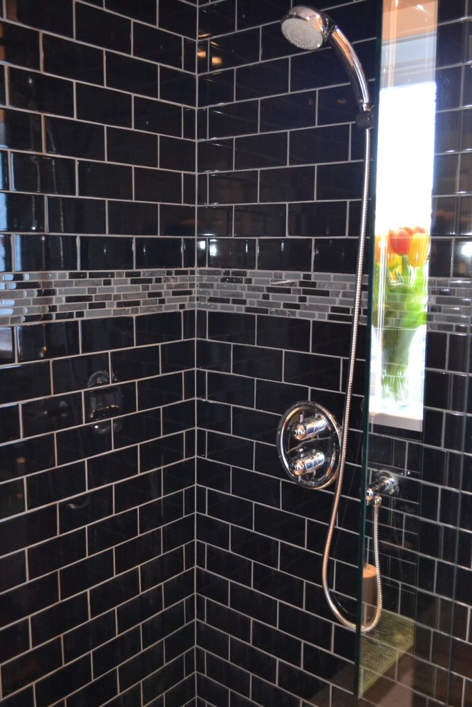 Black glass custom tiled shower with window